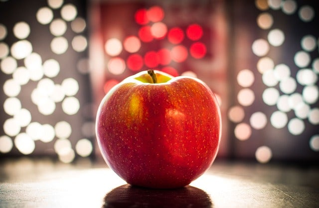 An apple in front of lights