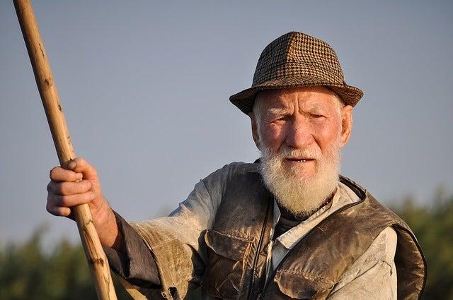 fisherman holding pole