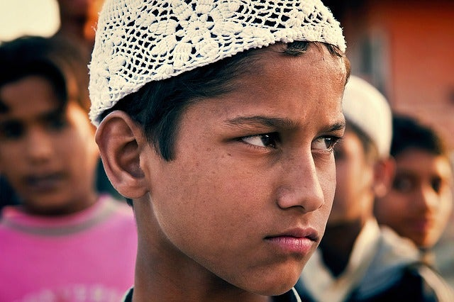 indian boy with frown