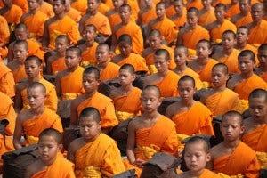 thai monks sitting in prayer