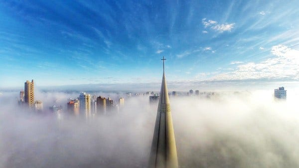 drone image above city in mist