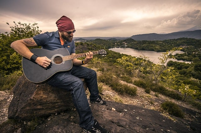 guitarist on mountaintop