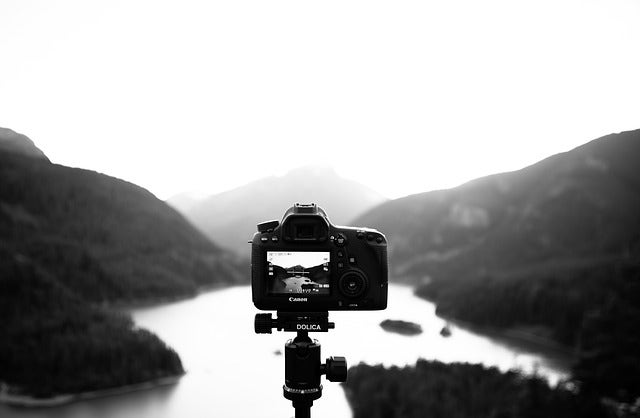 DSLR capturing image of a landscape
