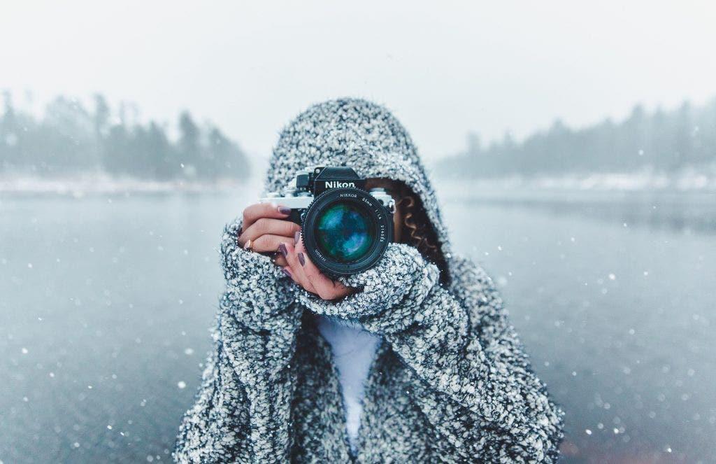 girl-takes-photo-in-snow