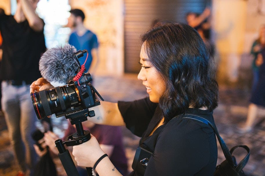 vlogger with camera and microphone