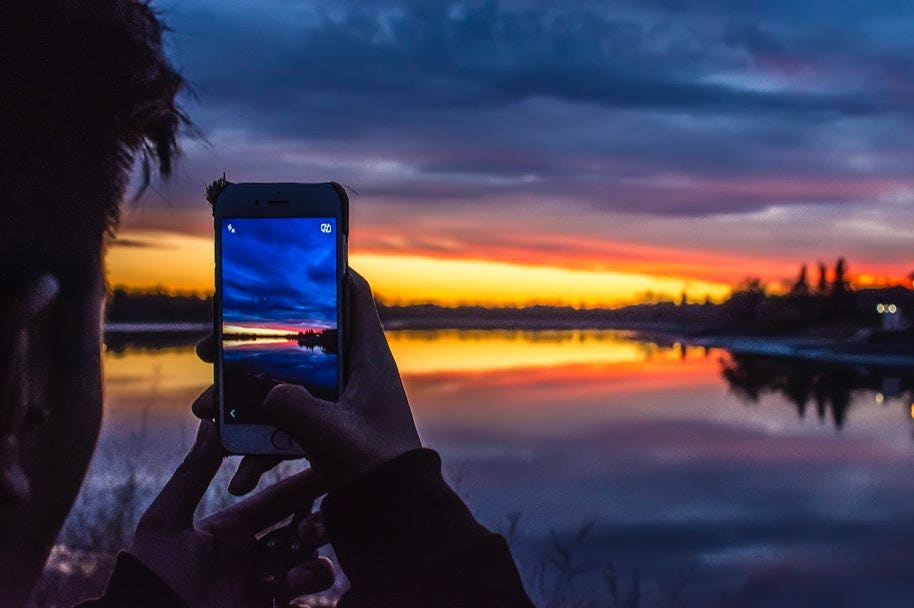 taking sunset photo on phone