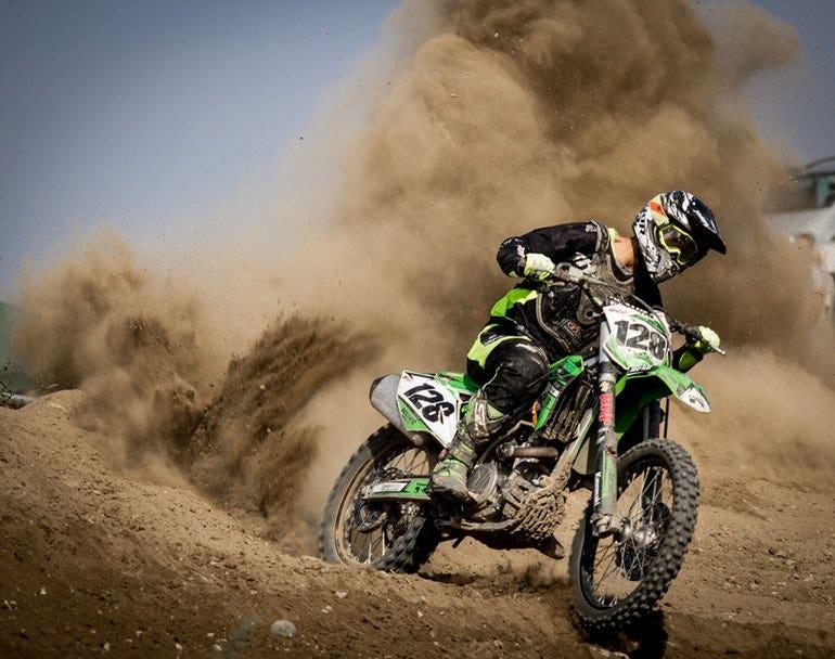 biker with sand behind