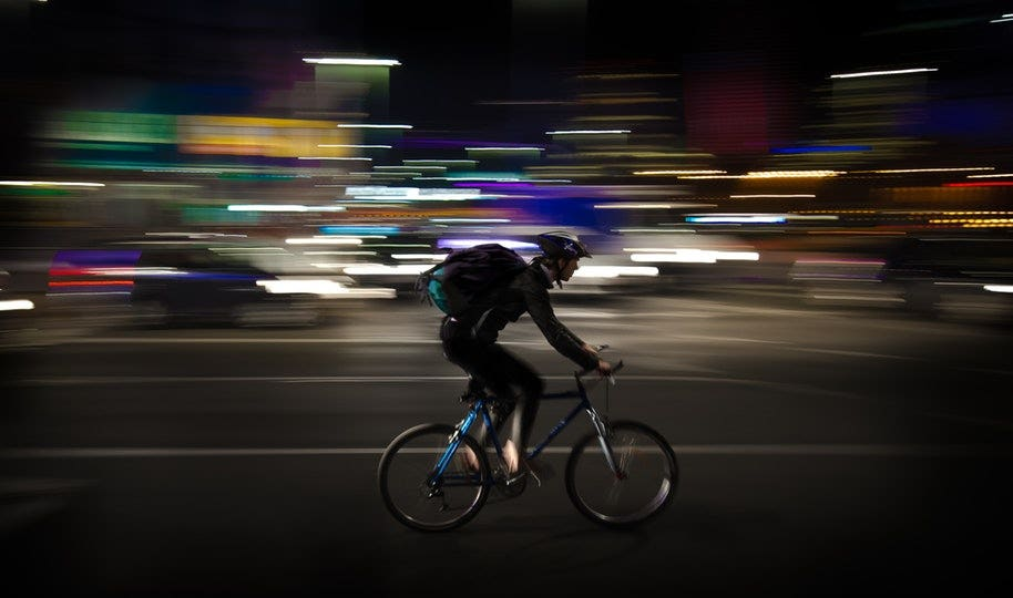 cyclist in panned sports photo