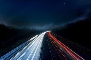 light trails on dark road at night