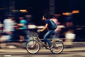 man on bike with blurred background