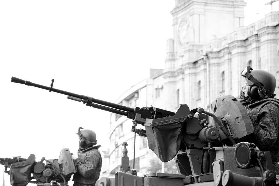 men in tanks protecting building