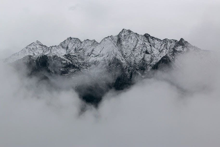 mountaintop shrouded in clouds