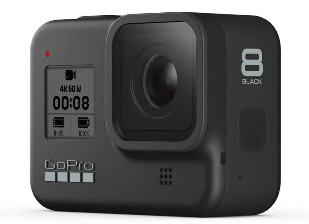 A view of the GoPro HERO8 action camera from the front with its large lens and black and white display