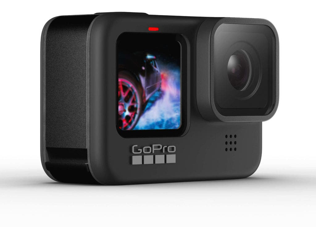 A GoPro HERO9 action camera with its large lens and colour live preview front screen.